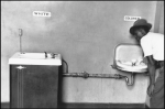 Elliott Erwitt. Segregated water fountains